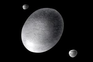 Concepção artística de Haumea e suas luas, Hi'aka e Namaka.